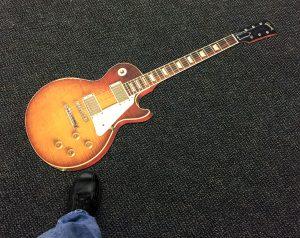 Dyesub soft flooring cut to custom guitar shape.